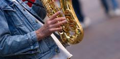 Picture of a busker playing a saxophone